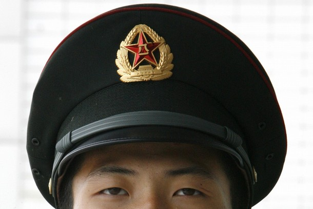 A People's Liberation Army soldier keeps watch at a camp in Beijing