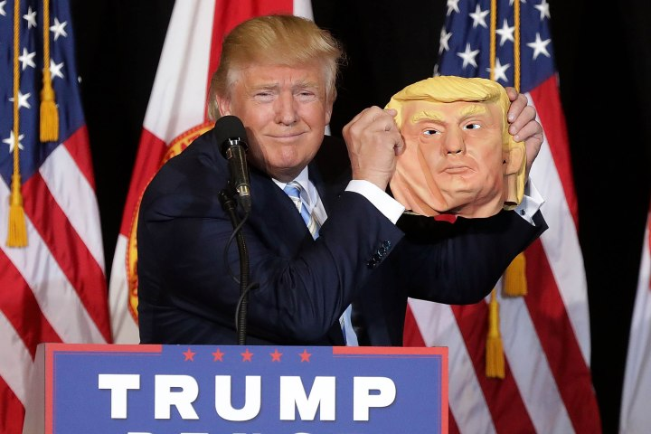 SARASOTA, FL - NOVEMBER 07: Republican presidential nominee Donald Trump holds up a rubber mask of himself during a campaign rally in the Robarts Arena at the Sarasota Fairgrounds November 7, 2016 in Sarasota, Florida. With less than 24 hours until Election Day in the United States, Trump and his opponent, Democratic presidential nominee Hillary Clinton, are campaigning in key battleground states that each must win to take the White House. (Photo by Chip Somodevilla/Getty Images)